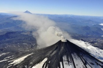 An aerial view shows smoke and ash rising from Villarrica Volcano, south of Santiago