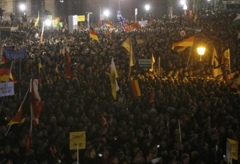 German citizens protest immigration of Muslims.