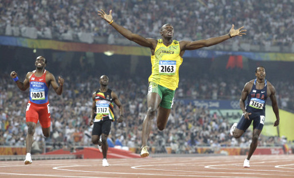 Jamaica's Usain Bolt crosses finish line to win gold medal in the men's 200-meter final at the Beijing 2008 Olympics.